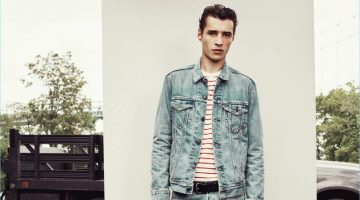Adrien Sahores models Levi's 501 skinny jeans in the brand's Hillman wash.