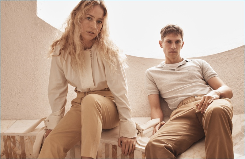 Models Raquel Zimmermann and Mathias Lauridsen model neutral fashions from Mango's Committed Collection.