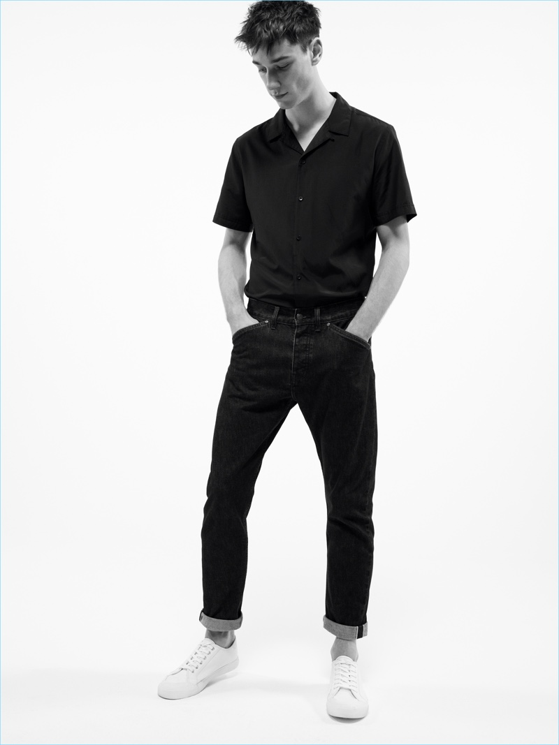 Harvey James embraces black denim with a Cuban collared short-sleeve shirt from Mango Man.