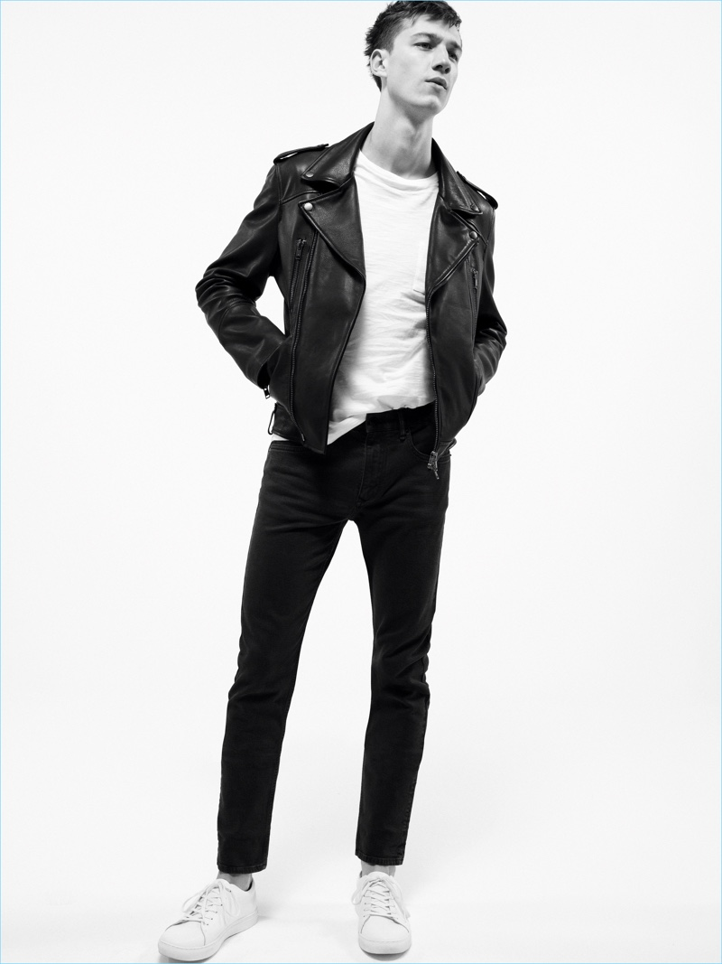 Playing it cool, Harvey James sports black denim jeans with a white tee and leather biker jacket by Mango Man.