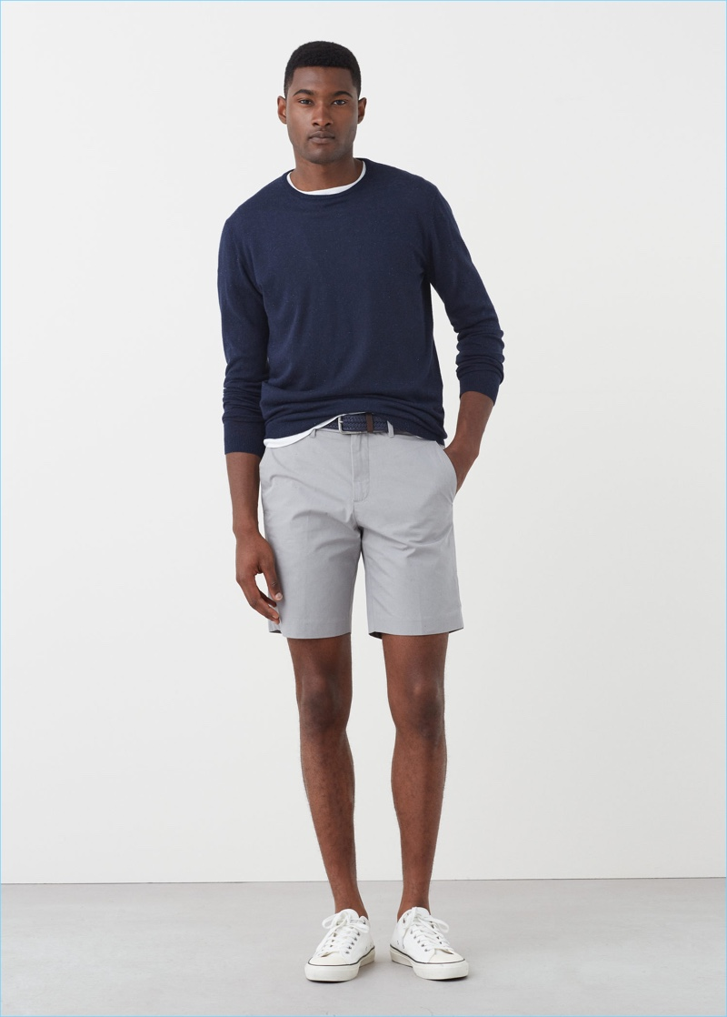 Mango Man makes a smart style suggestion, pairing its grey Bermuda shorts with a navy pullover.