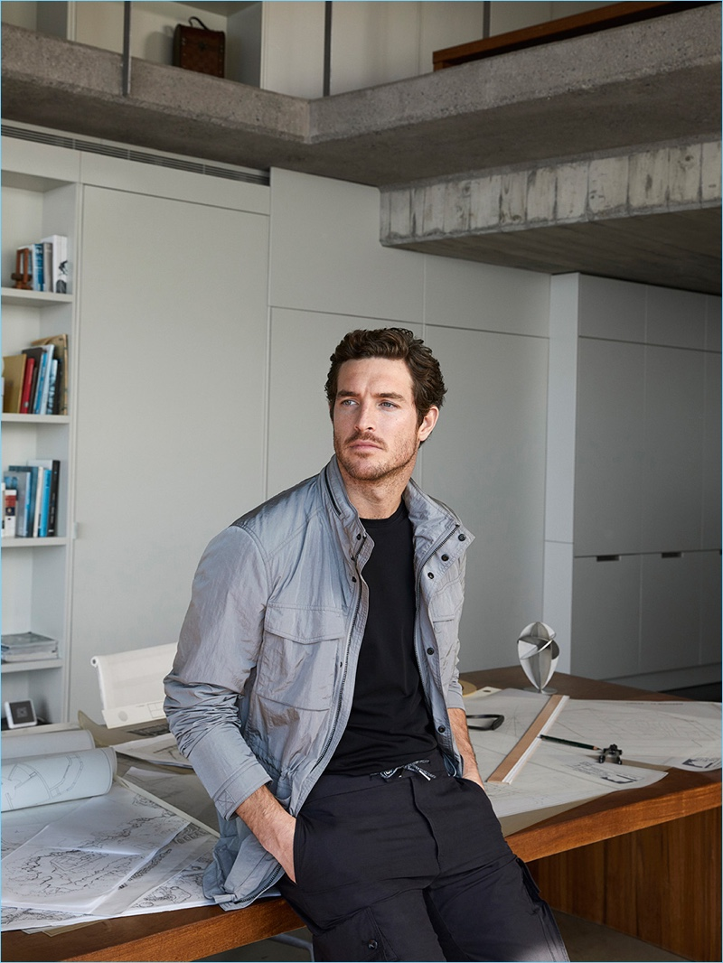 Wearing casual styles from Massimo Dutti's Soft Collection, Justin Joslin sports a technical jacket with a tee and cargo pants.