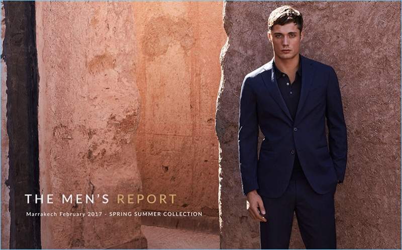 Steven Chevrin dons a polo and blue suit for Massimo Dutti's spring-summer 2017 campaign.