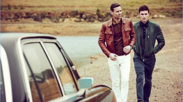 Left: Cornelius wears a brown Prada leather jacket and virgin wool polo shirt. Dan May also styles Cornelius in Dolce & Gabbana white denim jeans with Saint Laurent sneakers. Right: Charlie Timms sports a Brunello Cucinelli leather bomber jacket and cotton twill trousers. The English model also dons a Tom Ford polo shirt and Burberry sneakers.