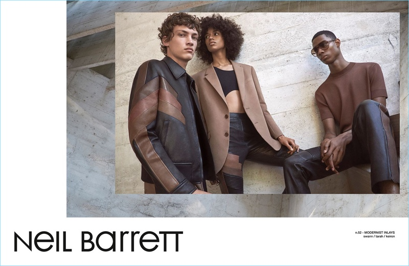 Sporting leather from Neil Barrett, models Swann Guerrault, Tarah Rodgers, and Keiron Caynes appear in the brand's spring-summer 2017 campaign.