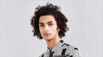 Model Tre Samuels sports Neuw's black lines rayon button-down shirt from Urban Outfitters.