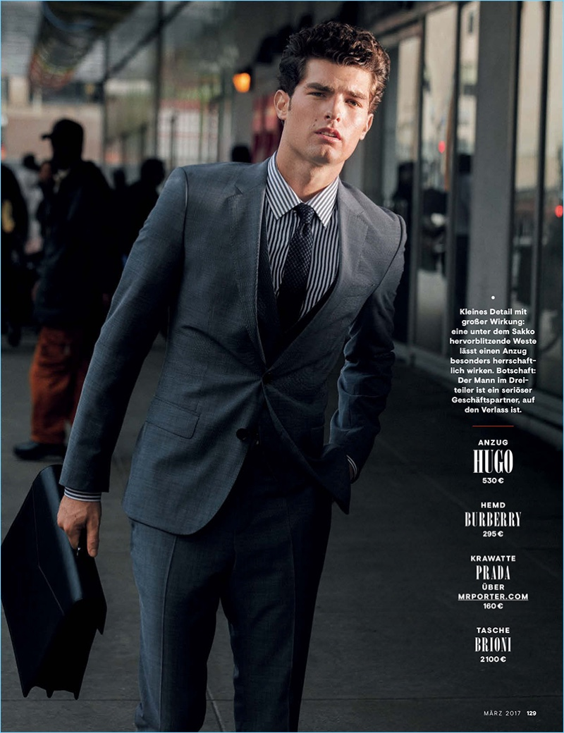 Embracing a business look, Paolo Anchisi wears a suit by HUGO Hugo Boss.