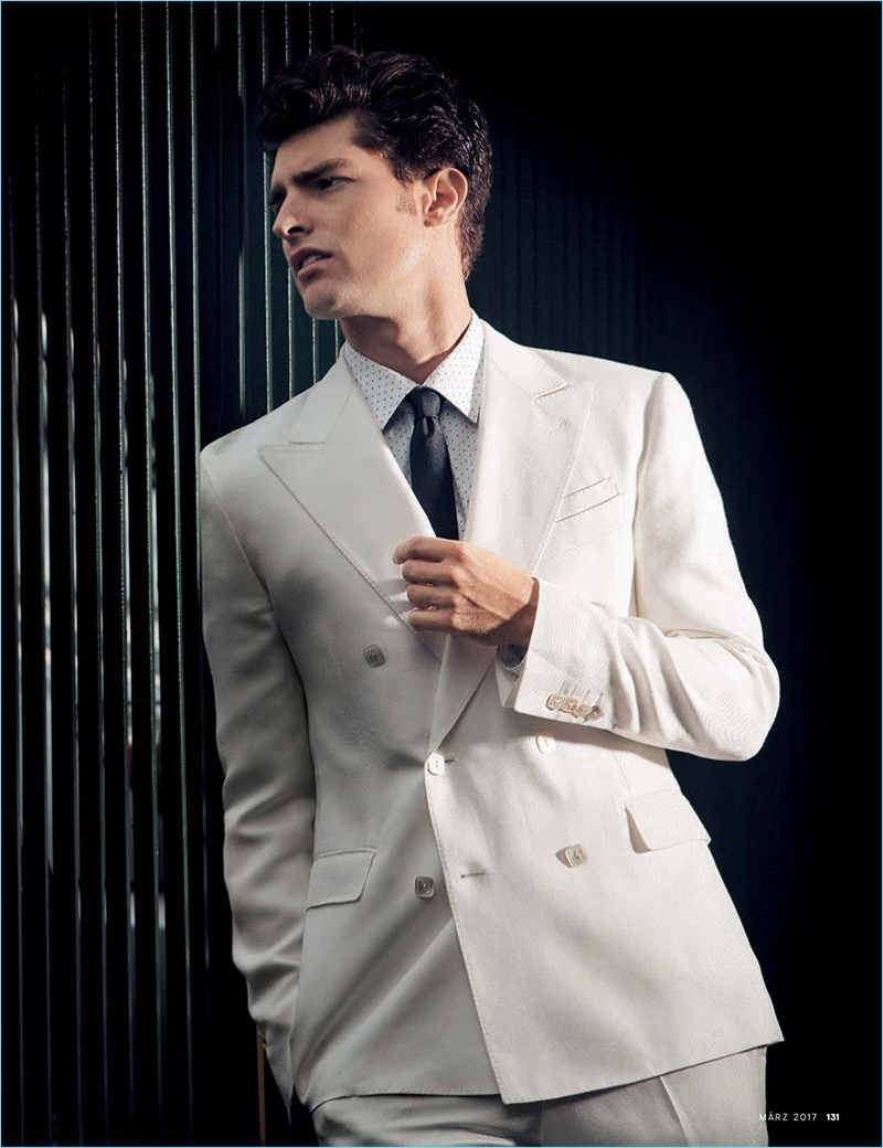 A vision in white, Paolo Anchisi wears a double-breasted suit from Billionaire.