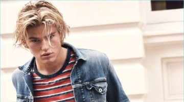 Jordan Barrett rocks jeans and a denim jacket with a striped tee for Pepe Jeans' spring-summer 2017 campaign.