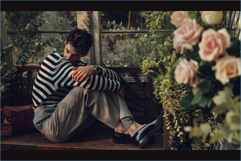 Norman Jean Roy photographs Pierre Niney in a striped Ermanno Scervino sweater with Fendi trousers and Church's dress shoes.