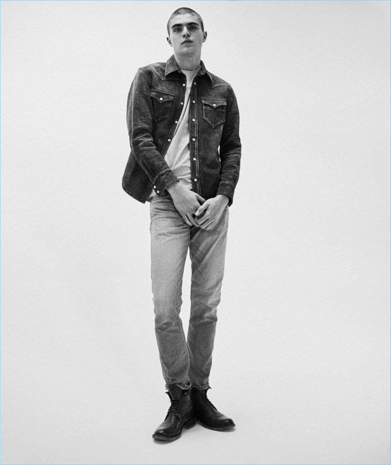 Doubling down on denim, Diego Villarreal wears a suede shirt and jeans by RRL with Rick Owens army boots.