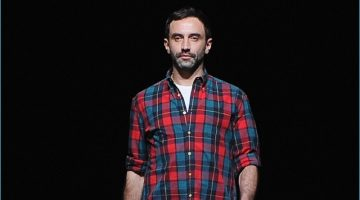 Designer Riccardo Tisci takes the catwalk following a show for Givenchy.