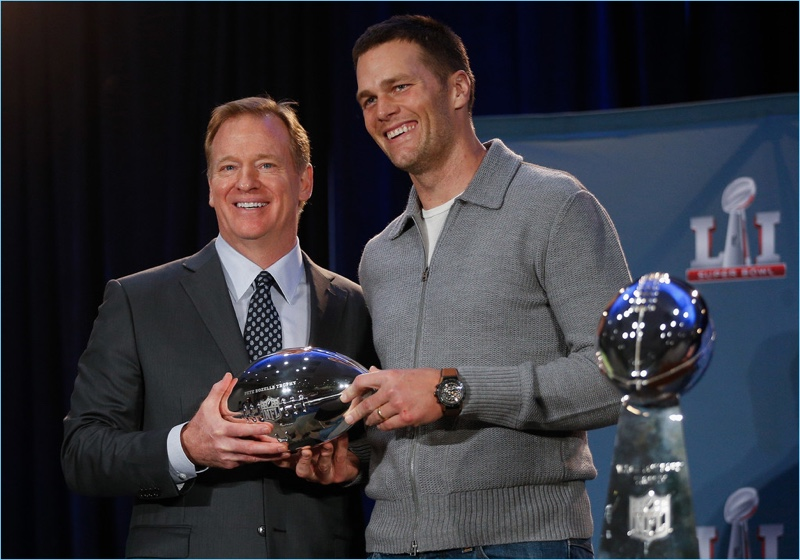 Tom Brady poses for pictures with NFL Commissioner Roger Goodell at the Super Bowl Winner and MVP press conference in Houston, Texas.