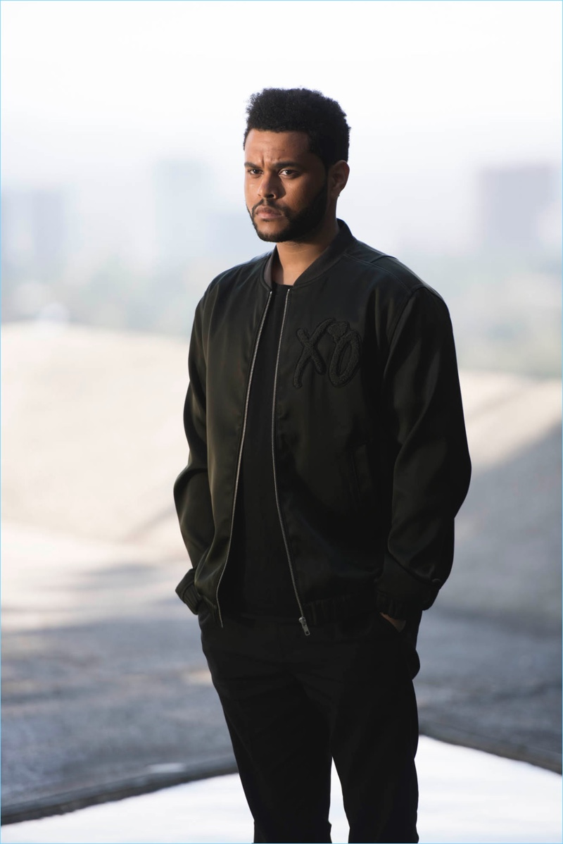 Stepping outdoors, The Weeknd wears a bomber jacket for his H&M campaign.