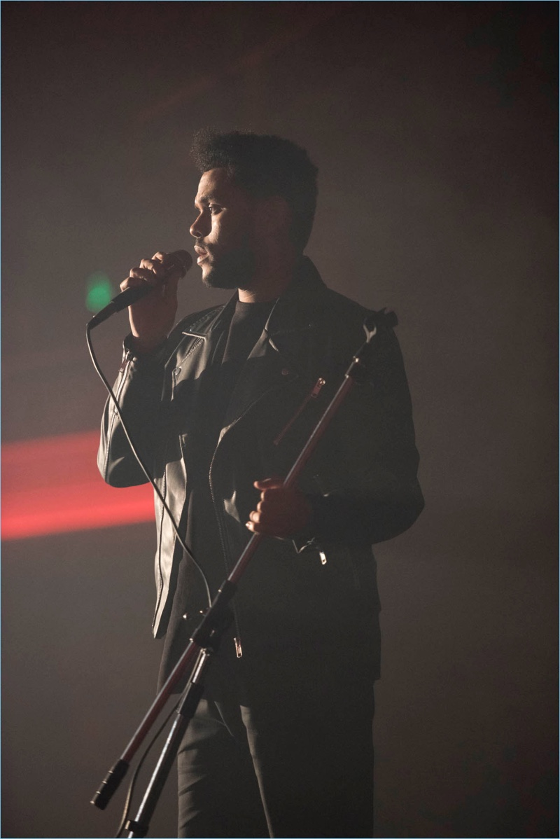 Performing, The Weeknd sports a leather jacket for his H&M campaign.