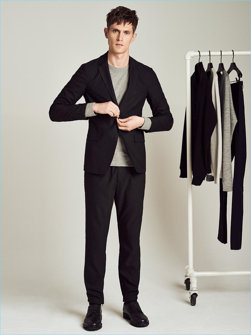 Theory's tech knit jacket is front and center as Mathias Lauridsen wears it with a sweatshirt and jogger pants.