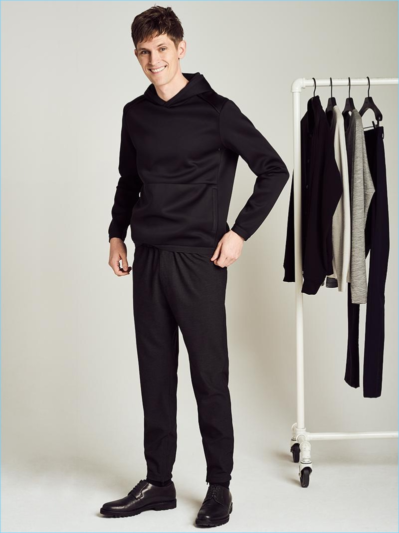 Elevating sporty style, Mathias Lauridsen wears a neoprene hooded sweatshirt and jogger pants by Theory.
