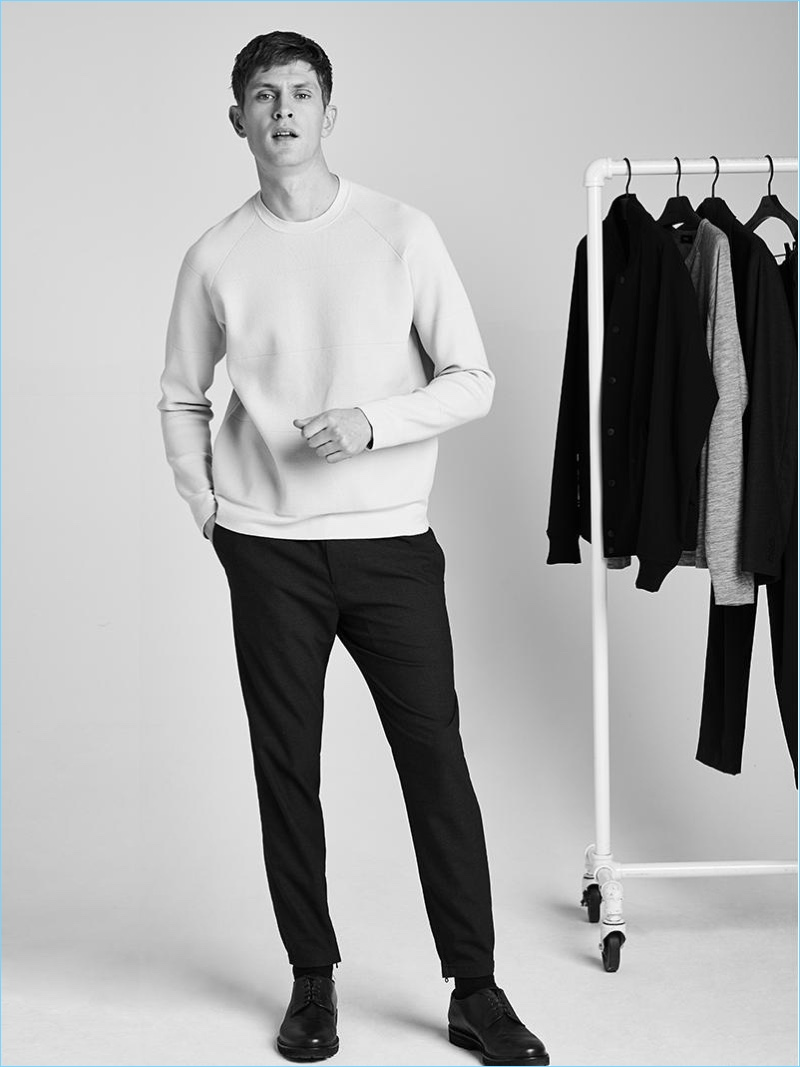 Mathias Lauridsen plays it casual in a tech knit crewneck and jogger pants from Theory.