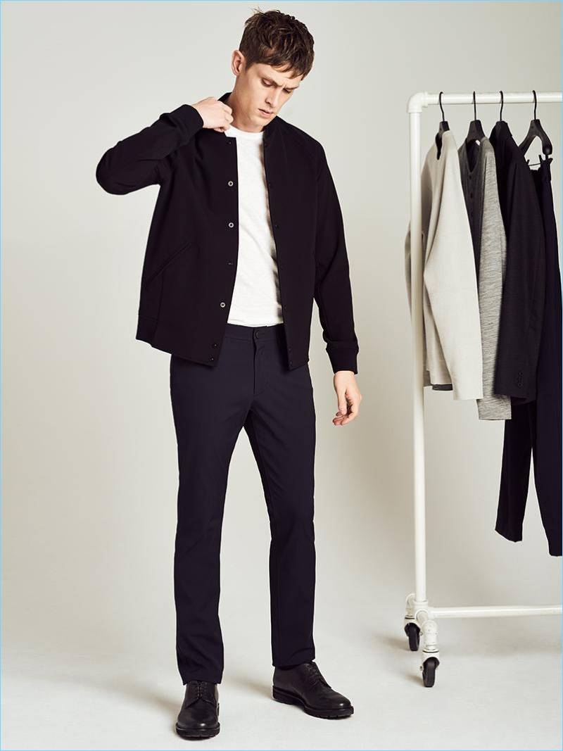 Danish model Mathias Lauridsen sports Theory's chic varsity jacket with a tee and bonded jeans.