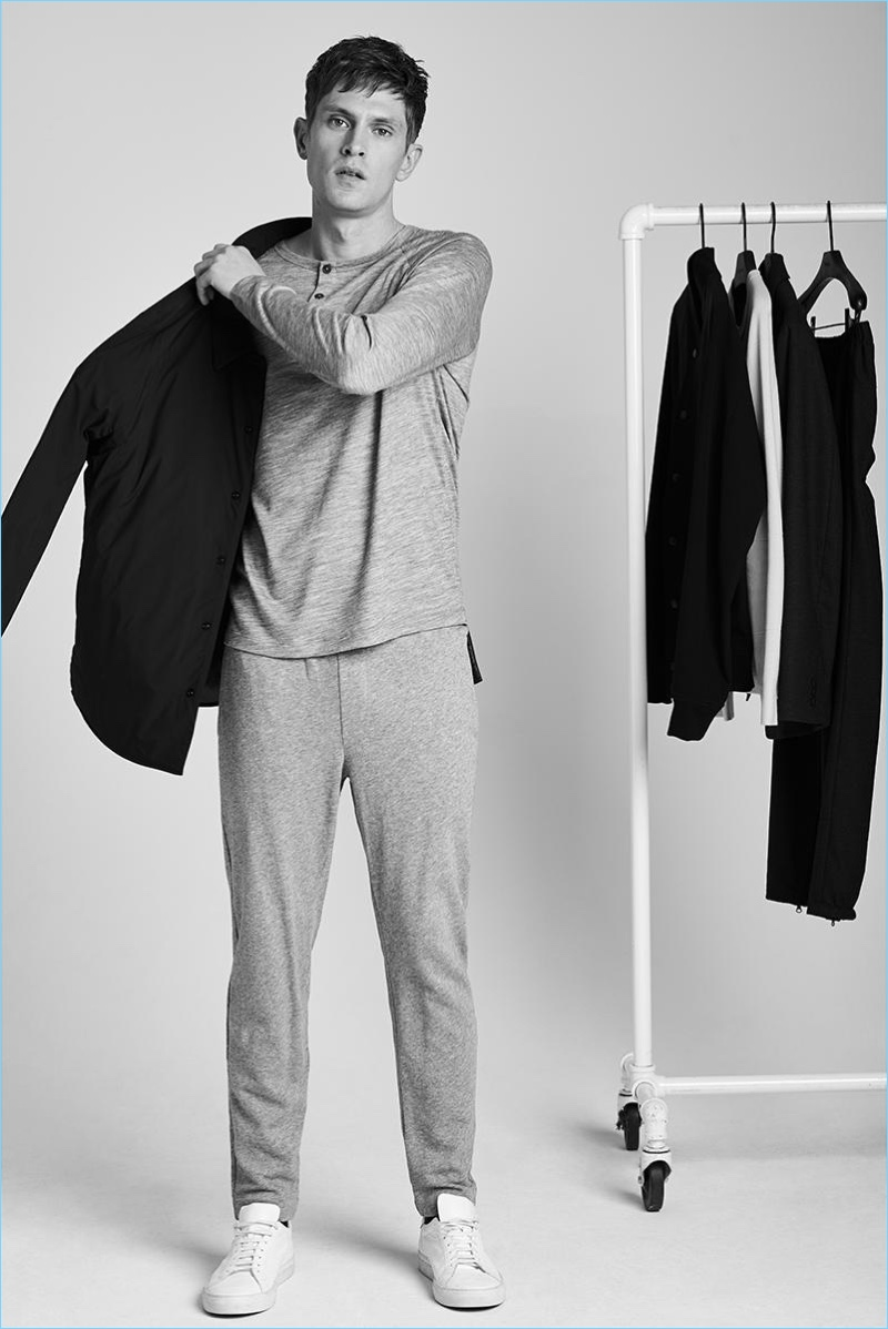 The very image of leisure, Mathias Lauridsen sports Theory's wool jersey henley with a coach jacket and sweatpants.