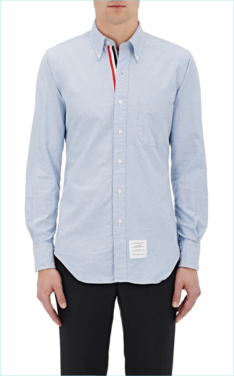 Thom Browne's shirts include the brand's signature red, blue, and white stripes.