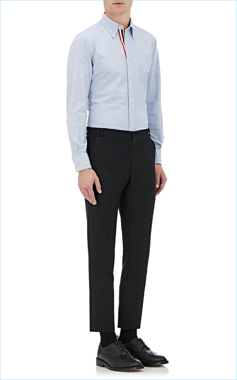 Barneys New York styles Thom Browne's blue oxford cloth shirt with a simple pair of cropped trousers and black dress shoes.