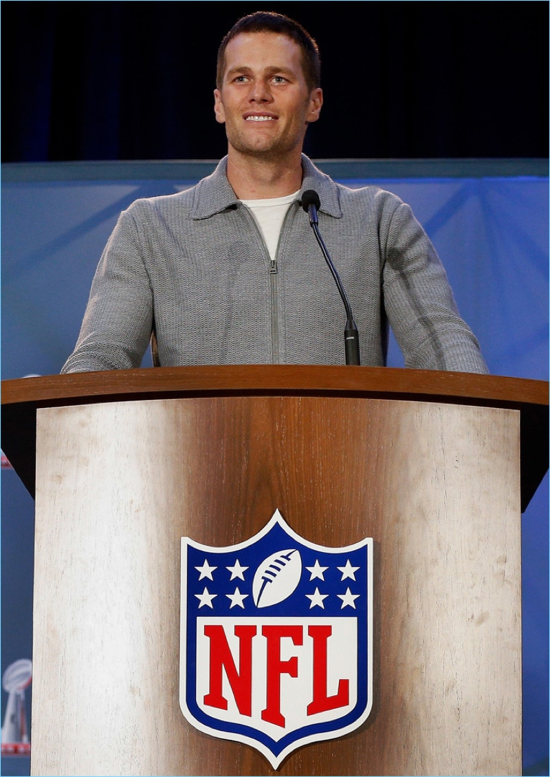 February 2017: Tom Brady dons a full-zip grey wool cardigan sweater by Tom Ford.