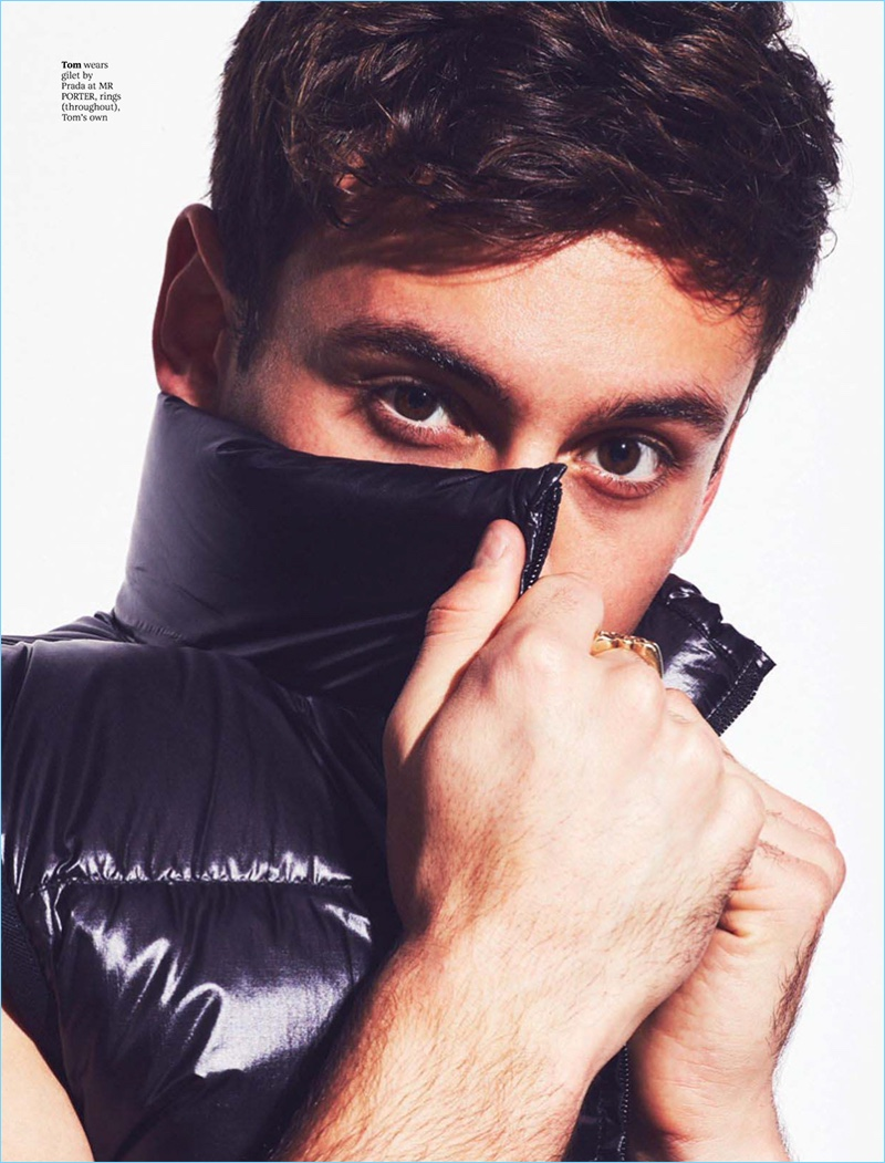 Appearing in a photo shoot for Attitude, Tom Daley plays coy in a Prada vest.