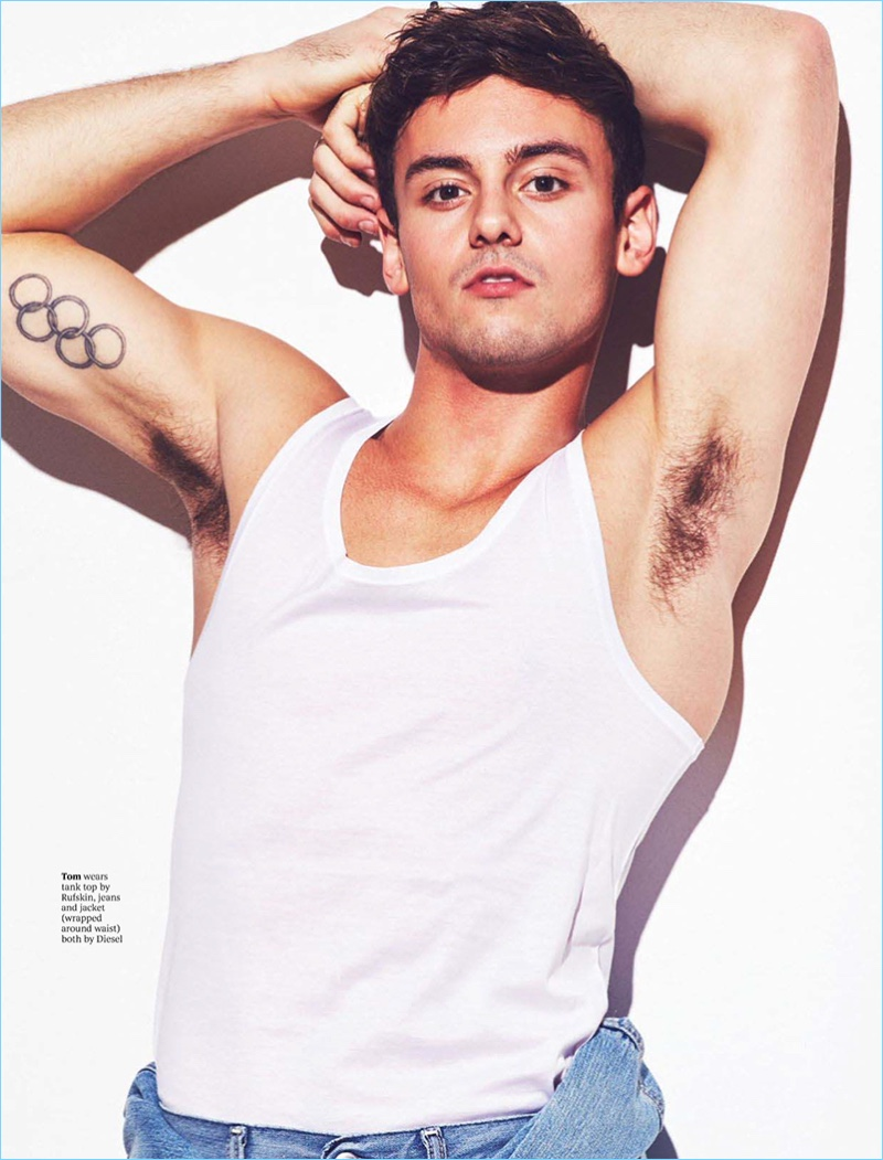 Showing off his biceps, Tom Daley wears a Rufskin tank with jeans and a jacket by Diesel.