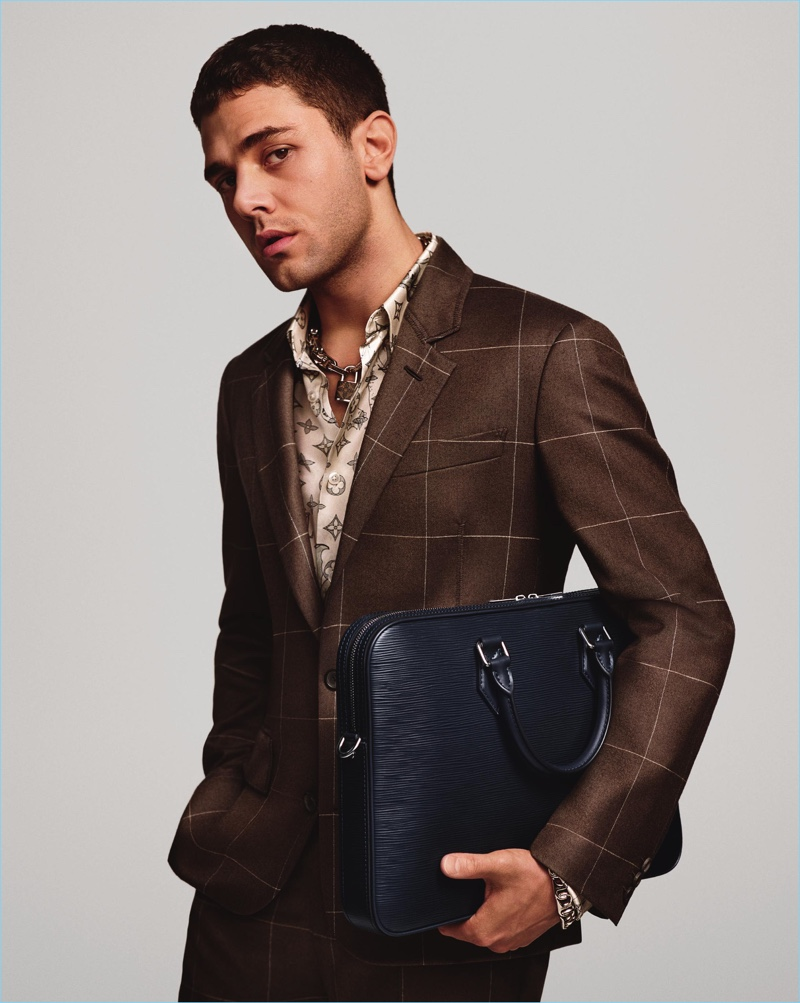 Xavier Dolan dons a windowpane print suit for Louis Vuitton's spring-summer 2017 campaign.