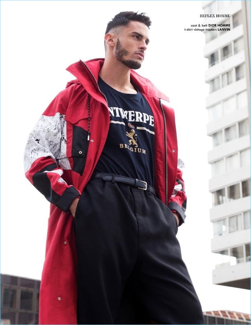 Embracing a sporty look, Baptiste Giabiconi wears a vintage t-shirt with Lanvin trousers. The French model also sports a Dior Homme coat and belt.
