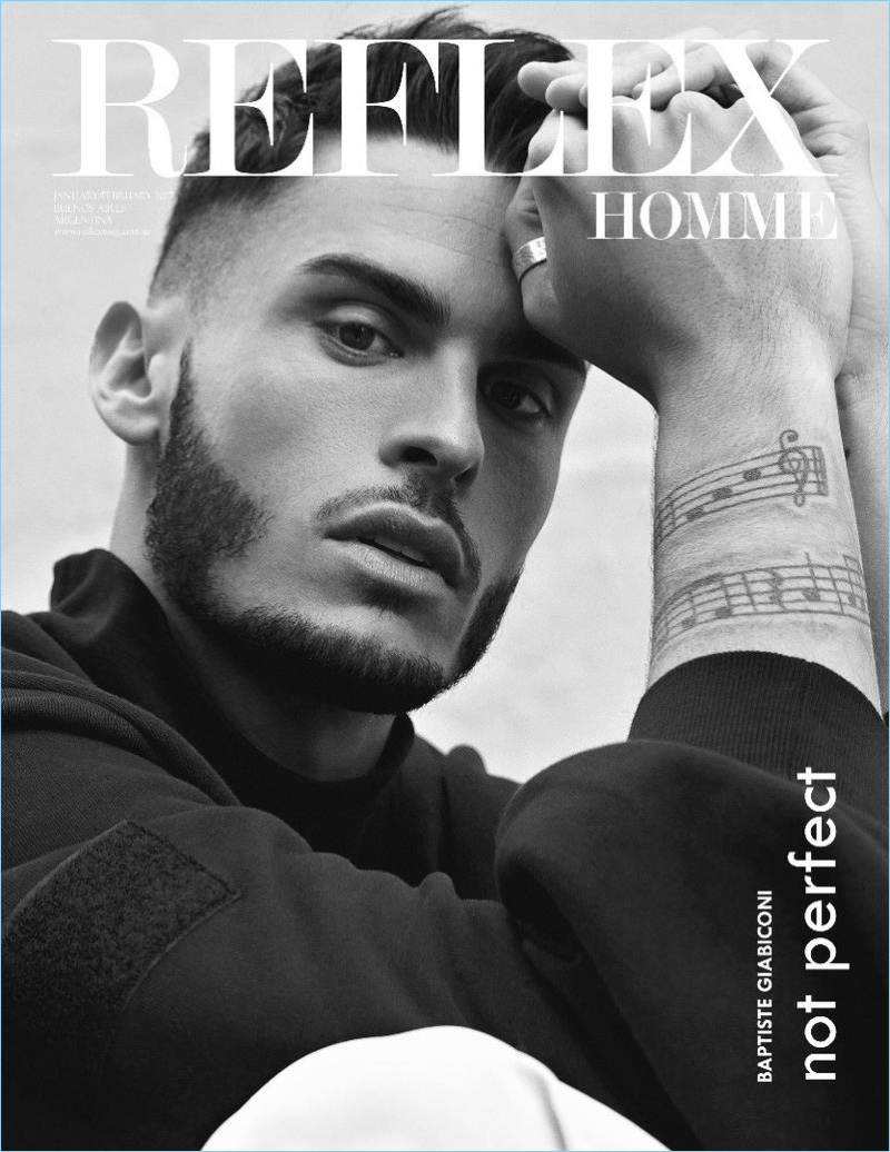 Appearing in a black and white image, Baptiste Giabiconi covers Reflex Homme.