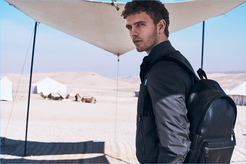 Accessorized for travel, Benjamin Eidem sports a leather backpack by Massimo Dutti.