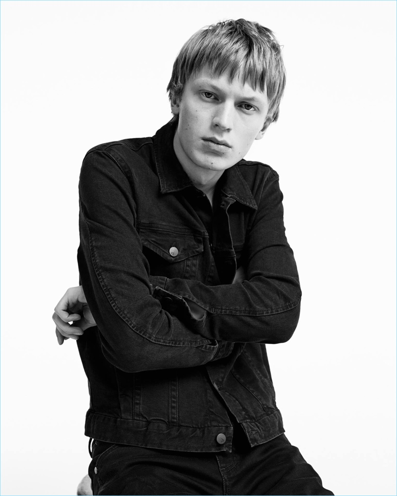 Jonas Gloer rocks a black denim jacket and jeans for Calvin Klein Jeans' spring-summer 2017 campaign.