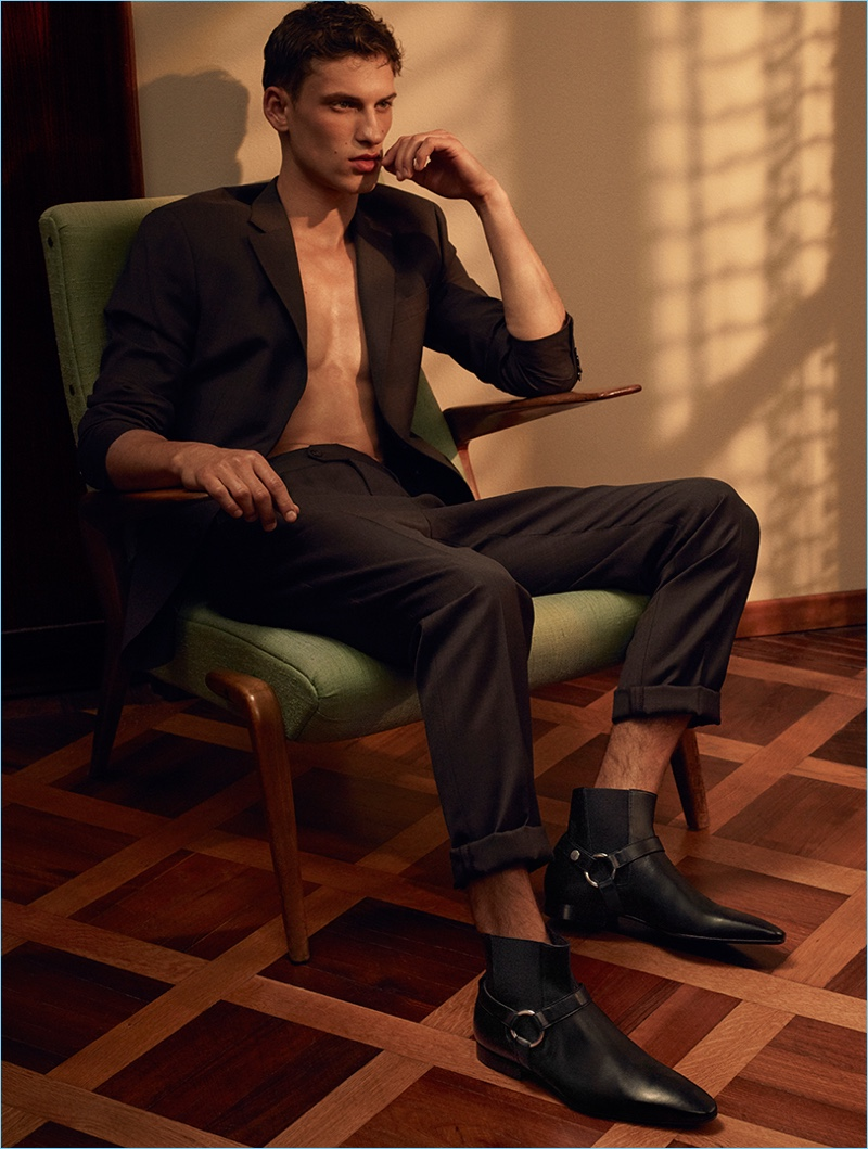 Model David Trulik wears leather ankle boots for Cesare Paciotti's spring-summer 2017 campaign.