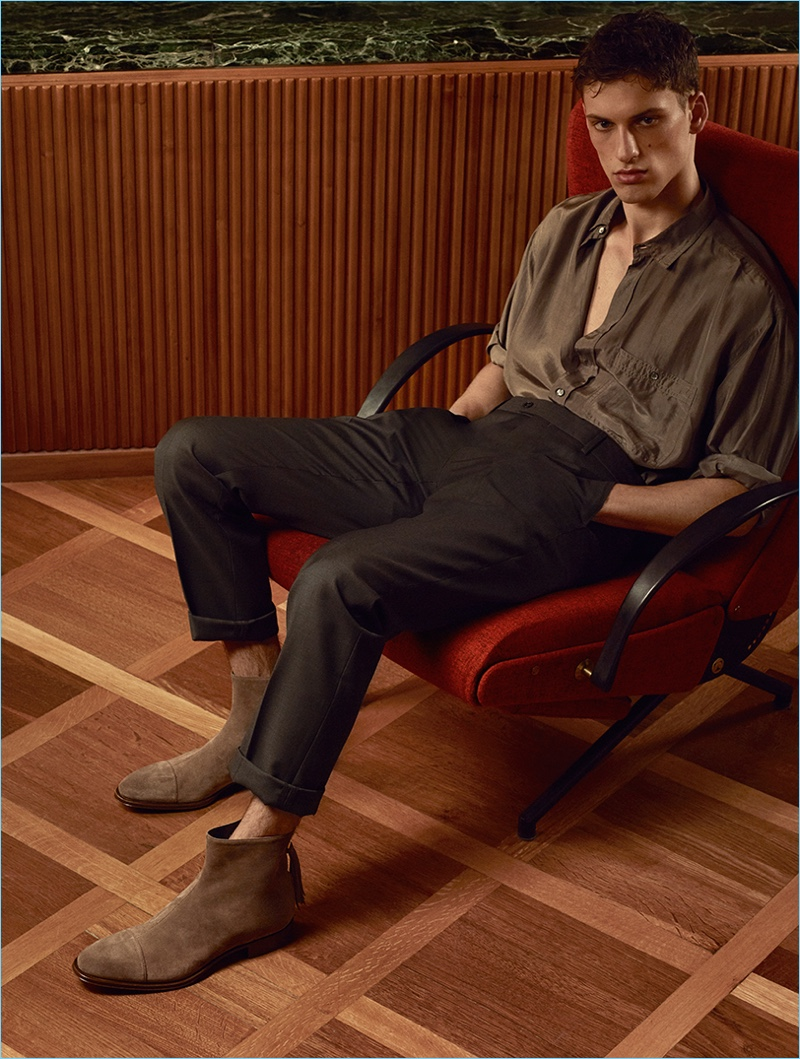 Starring in Cesare Paciotti's spring-summer 2017 campaign, David Trulik dons suede boots.