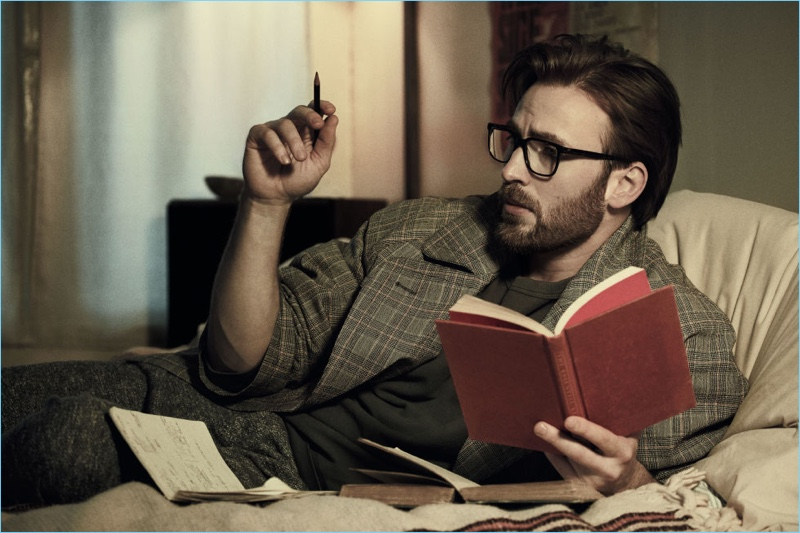 Donning glasses and reading a book, Chris Evans appears in a photo shoot for Esquire.