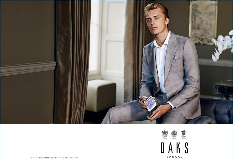 Max Rendell dons a check grey suit for Daks' spring-summer 2017 campaign.