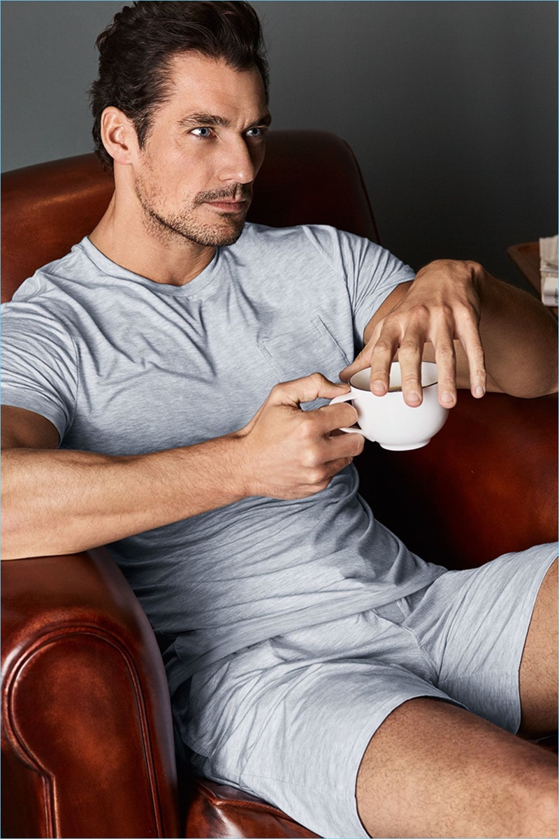 Enjoying a warm beverage, David Gandy wears cool grey separates from his new Autograph line.