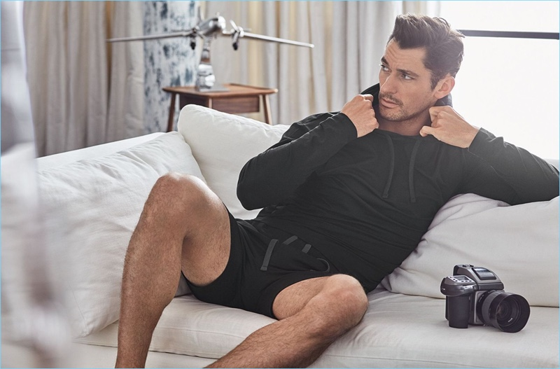 British model David Gandy sports a hooded top and shorts from his Autograph collection.