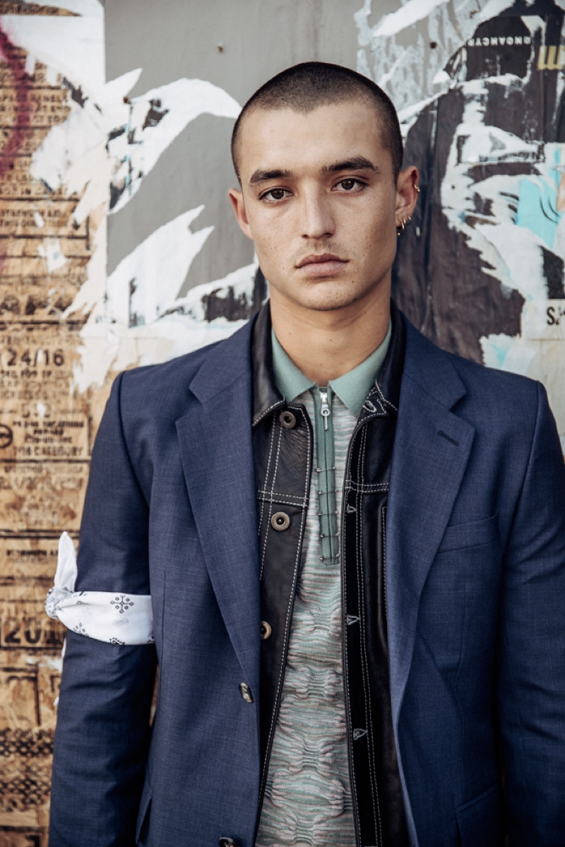 Kaleb wears polo Orley, leather jacket Diesel Black Gold, bandana stylist's own, and sport coat Éditions MR.