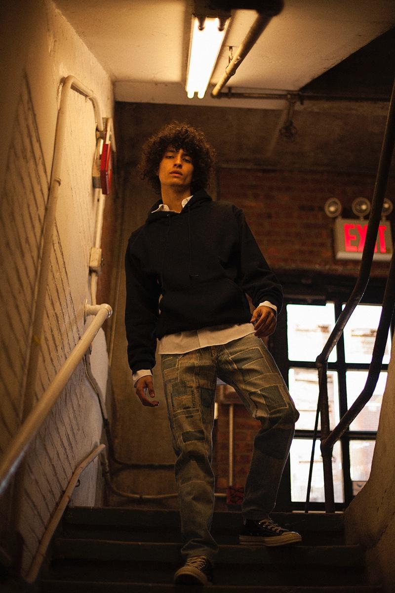 Liam wears hoodie Alternative Apparel, shirt Gosha Rubchinskiy, jeans Dries Van Noten, and shoes Converse.