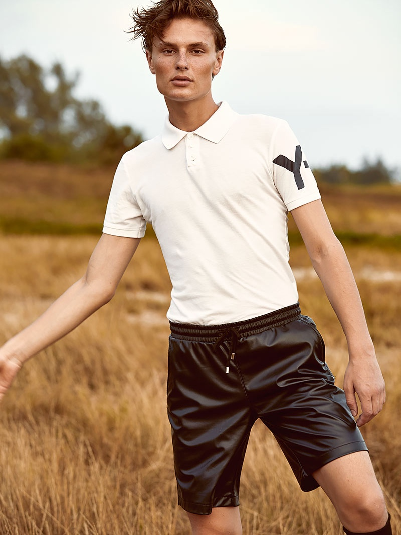 Vanya wears polo Y-3, shorts Dsquared2, and socks Adidas.