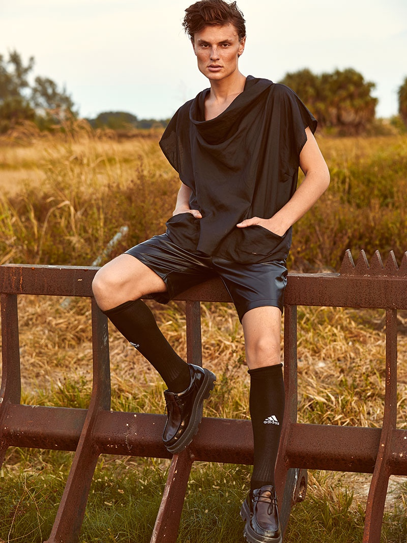 Vanya wears top Martin Margiela, shorts Dsquared2, socks Adidas, and shoes Carven.