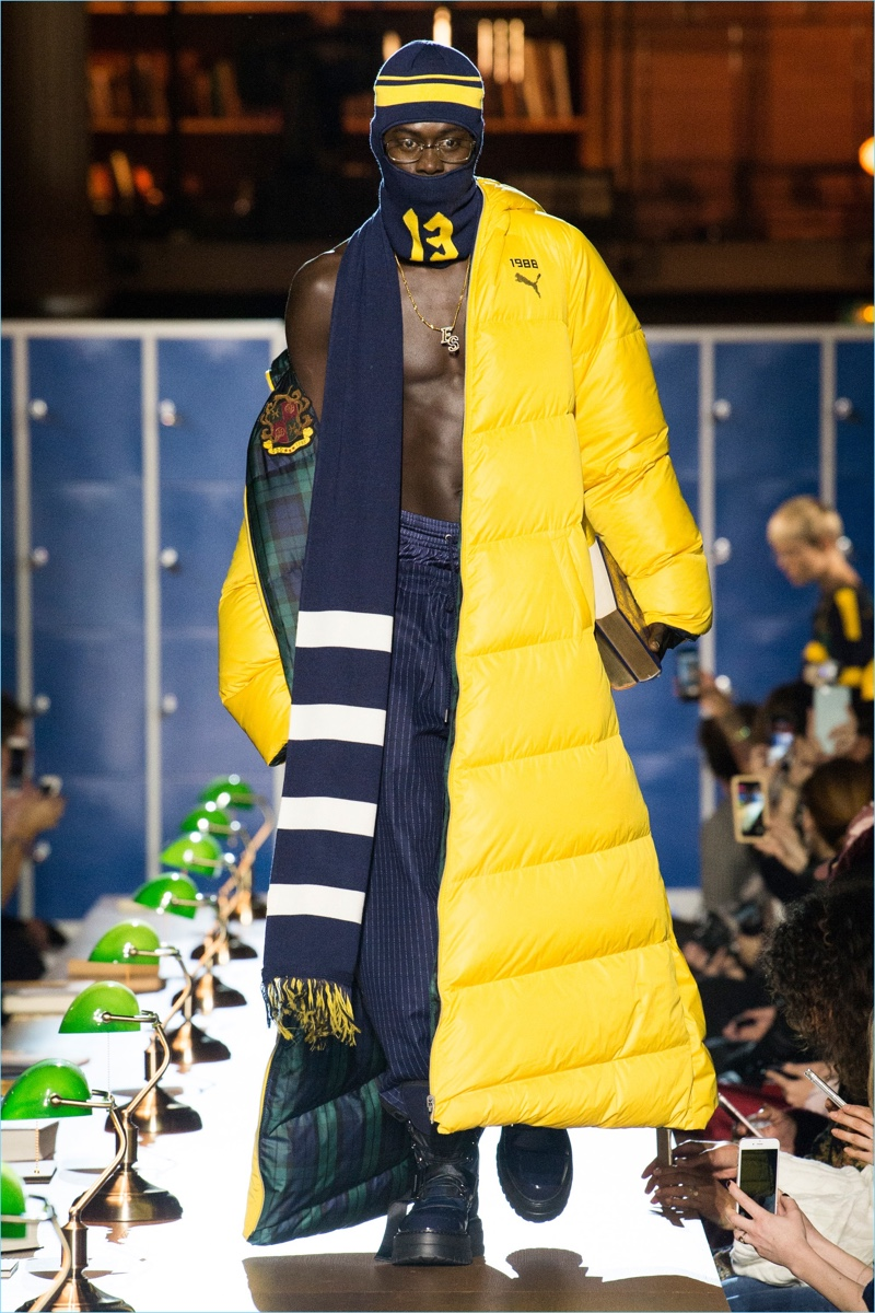 A yellow down coat adds a pop of color to Fenty x Puma's fall-winter 2017 collection.