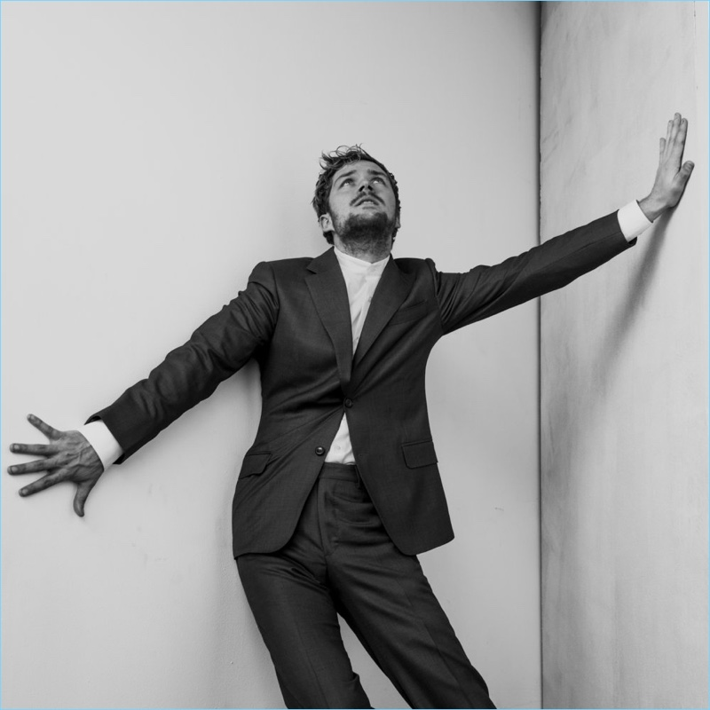 Donning a J.Hilburn suit, Finn Jones makes a dramatic pose for The Laterals.