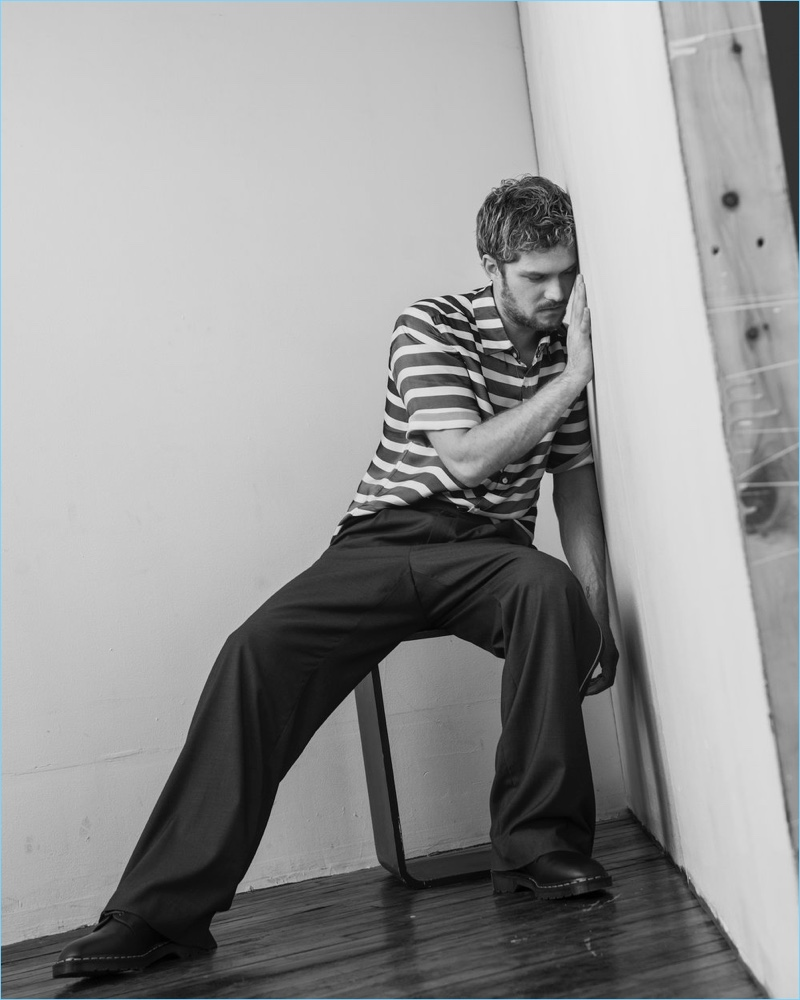 Actor Finn Jones sports a striped Exinfinitas shirt with Woodhouse pants, and shoes by Dr Martens x Engineered Garments.