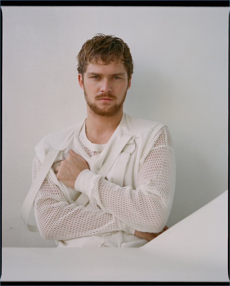 Sporting white, Finn Jones wears a Private Policy vest and a long-sleeve mesh shirt by Off-White.