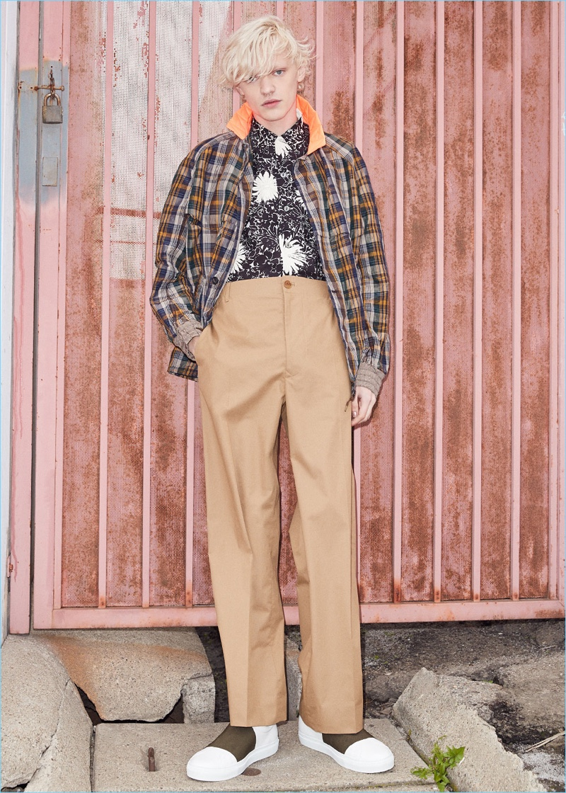 Front and center, Turner Barbur wears a Kolor check jacket with a Junya Watanabe cupra voile print shirt. Turner also sports Stella McCartney trousers with Givenchy leather skate elastic sneakers.