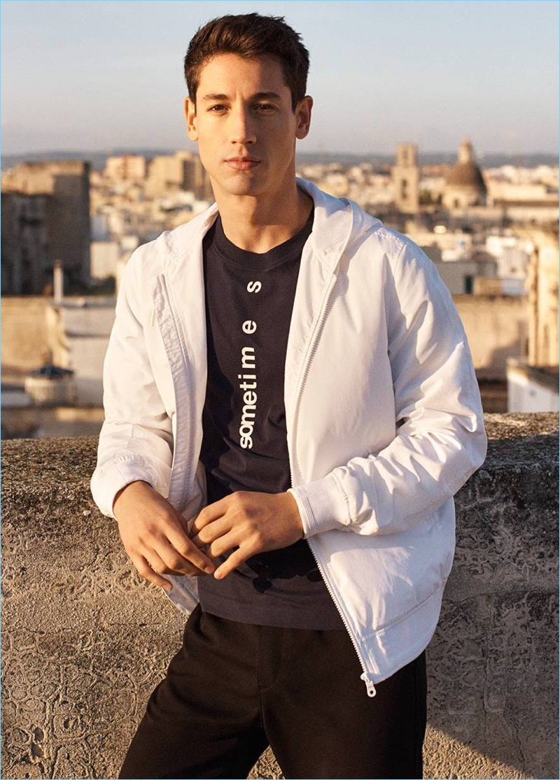 Model Nicolas Ripoll wears a t-shirt, windproof jacket, and cargo pants from H&M.